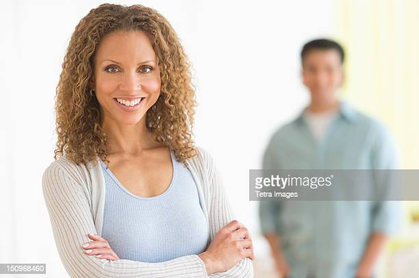 Portrait of couple with focus on woman in foreground
