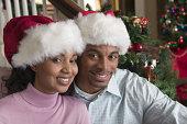Portrait of couple with santa hats