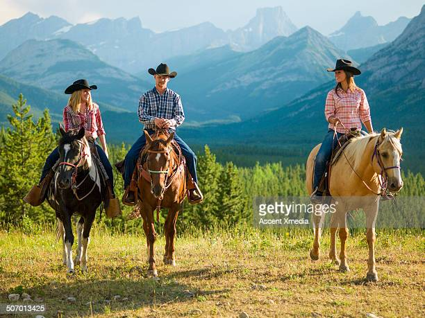 Portrait of cowboy & cowgirls in mountain setting