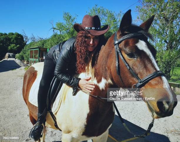 Portrait Of Cowgirl Riding On Horse