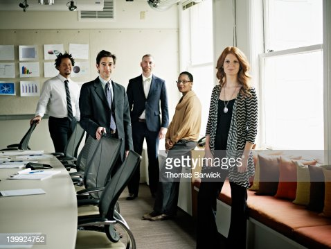 Portrait of coworkers standing in conference room : Stock Photo