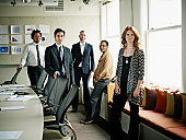 Portrait of coworkers standing in conference room