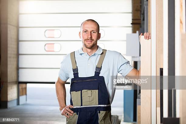 Portrait of craftsman on shop floor
