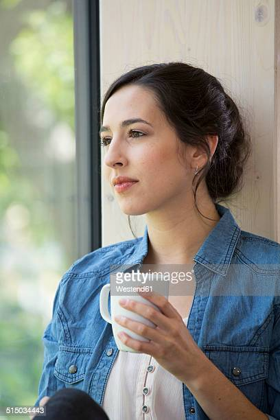 Portrait of creative business woman having coffee break