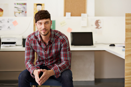 Portrait of creative businessman at office