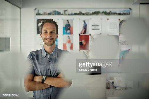 Portrait of creative businessman in his office