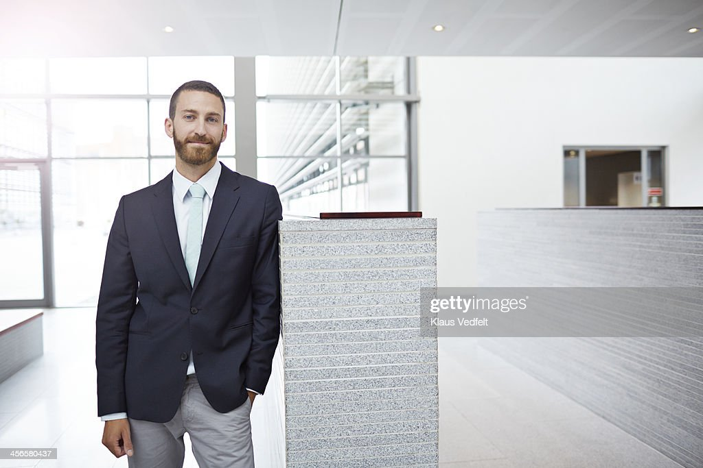 Portrait of creative businessman, standing in hall : Stock Photo