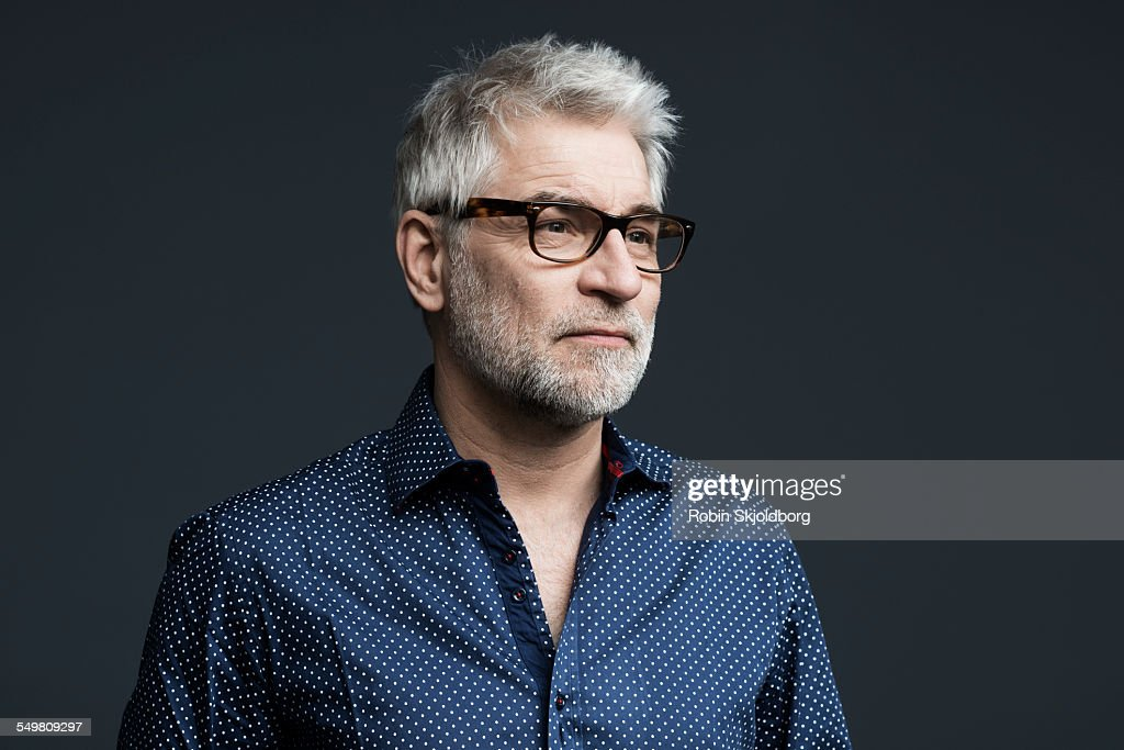 Portrait of creative man with grey hair