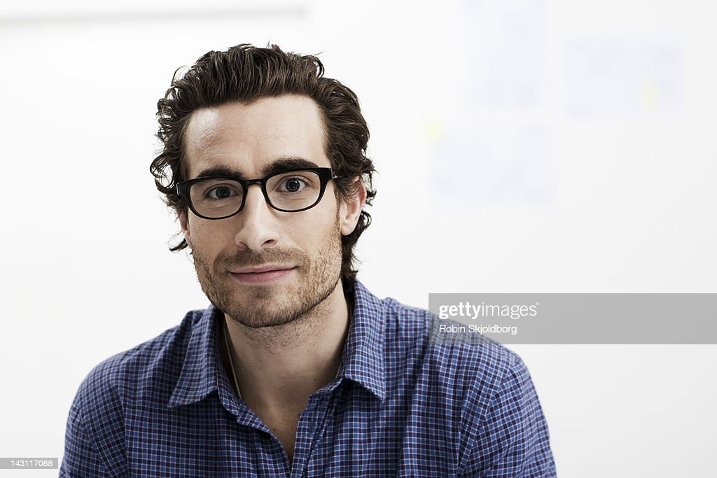 Portrait of creative young man with glasses : Stock Photo