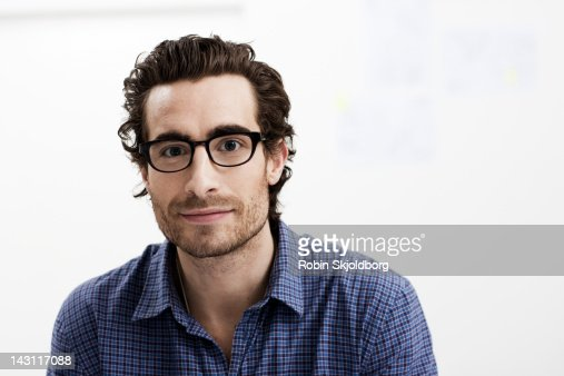 Portrait of creative young man with glasses