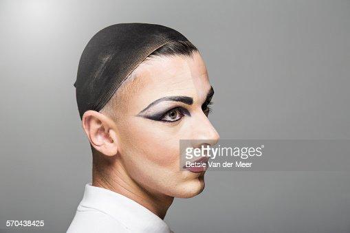 Portrait of cross dresser, half of face made up