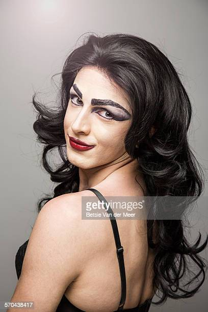 Portrait of cross dresser with long hair.