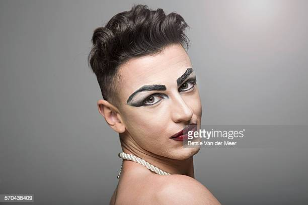 Portrait of cross dresser with short hair.