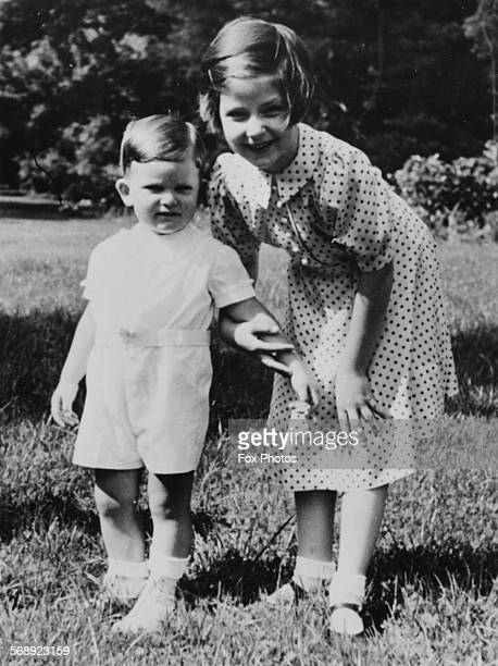 Portrait of Crown Prince Simeon and Princess Marie Louise of Bulgaria the children of King Boris III in a garden together June 18th 1939
