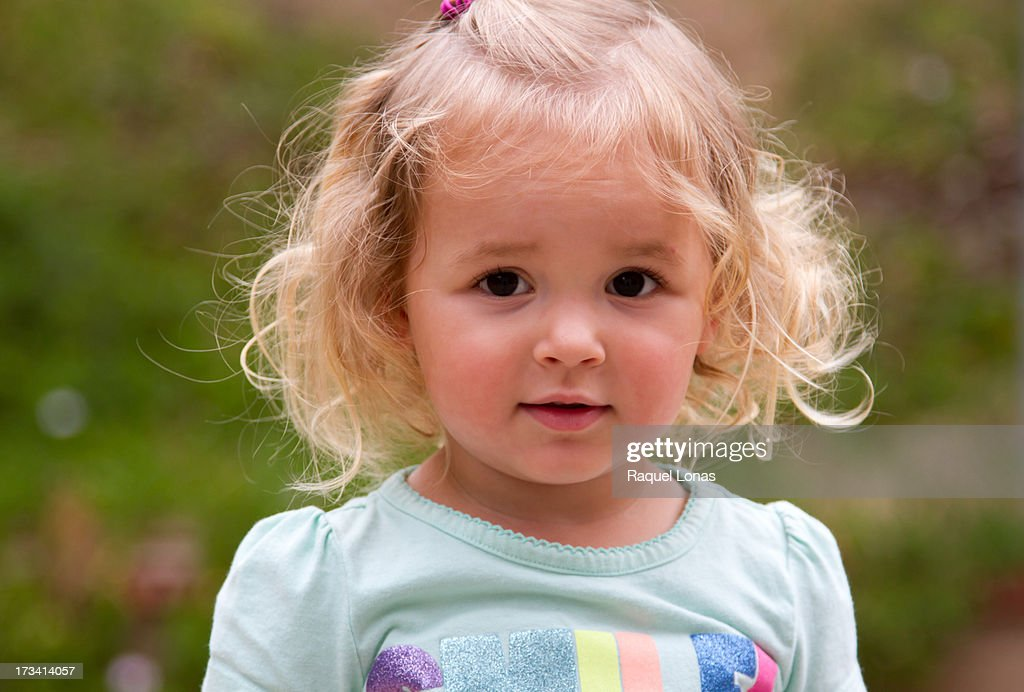 Portrait of curly haired blond female toddler : Stock Photo