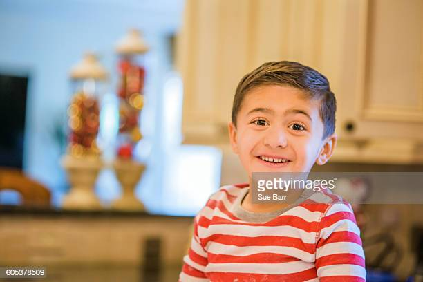 Portrait of cute boy in kitchen
