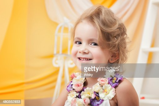 Portrait of cute little girl smiling at camera : Stock Photo