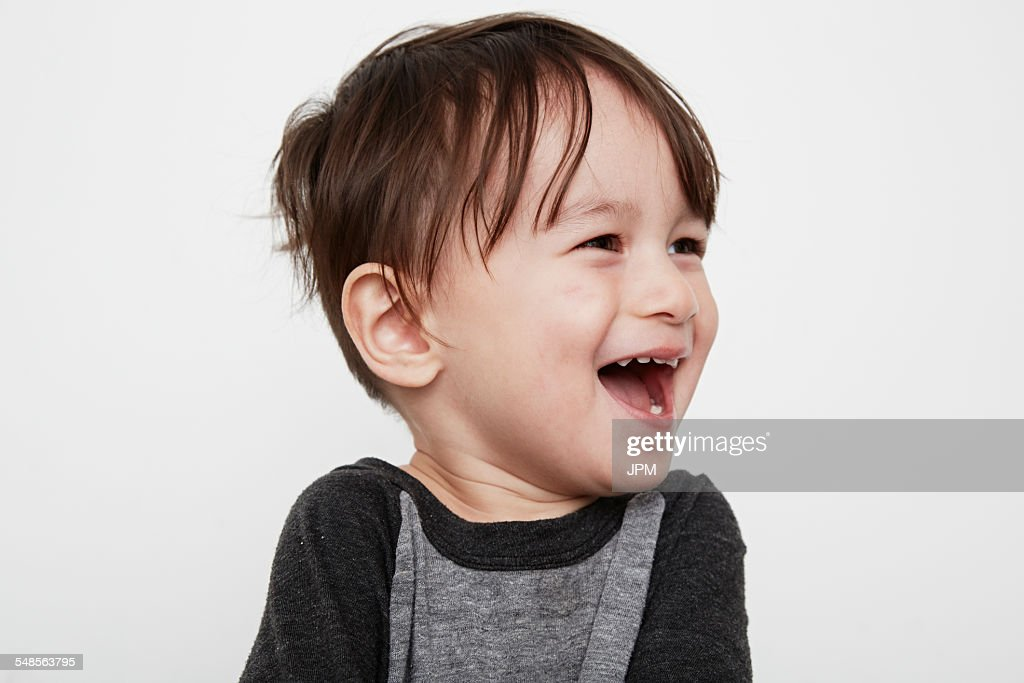 Portrait of cute male toddler laughing