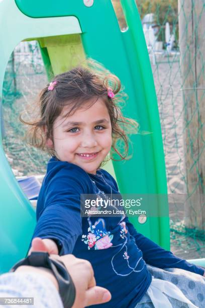 Portrait Of Cute Smiling Girl At Playground