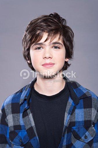 portrait of cute teenage boy stock photo thinkstock. Black Bedroom Furniture Sets. Home Design Ideas