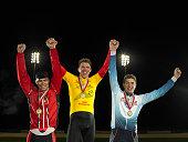 Portrait of cyclists celebrating on podium