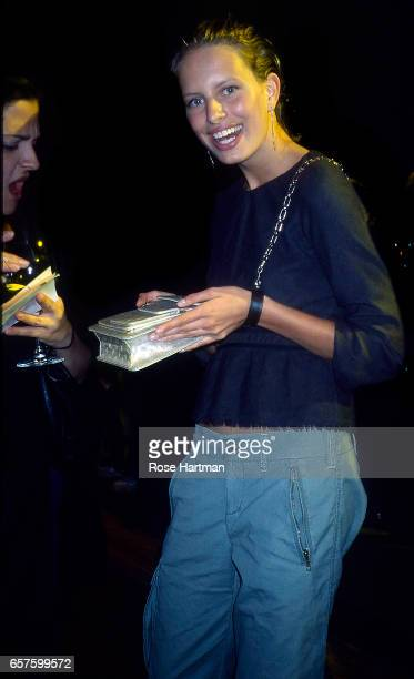 Portrait of Czech model Karolina Kurkova holds a purse as she poses backstage at a Anna Sui fashion show in Bryant Park New York New York 2002