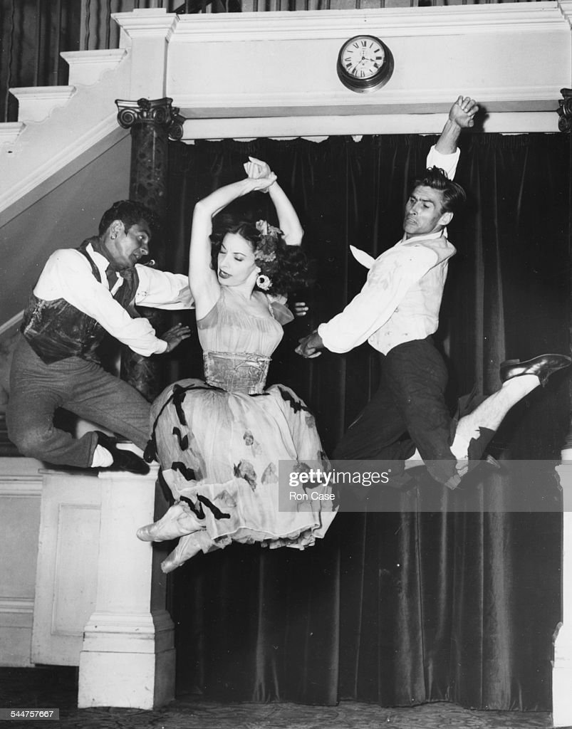 Portrait of dancers (L-R) Igor Youskevitch, Alicia Alonso and John Kriza posing in a mid-air leap during rehearsals at the Royal Opera House, London, July 13th 1953.