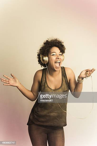 Portrait of dancing female Afro-American with headphones