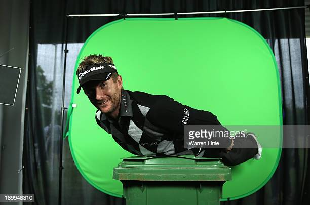 A portrait of David Lynn of England as he planks on a bin in front of a television greenscreen ahead of the BMW PGA Championship at Wentworth on May...