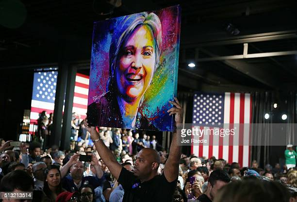 A portrait of Democratic presidential candidate former Secretary of State Hillary Clinton is held up during her event at Stage One at Ice Palace...