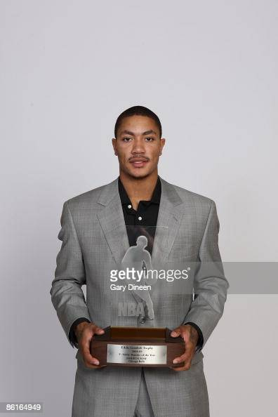 A portrait of Derrick Rose of the Chicago Bulls with the Eddie Gottlieb trophy presented to the TMobile NBA Rookie of the Year on April 22 2009 at...