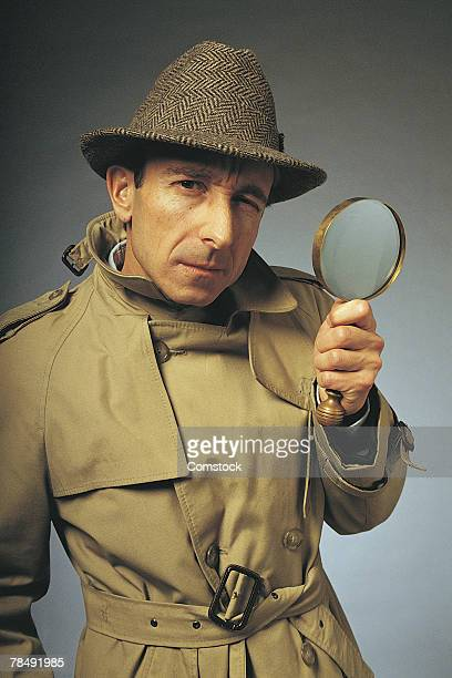 Portrait of detective with magnifier