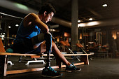 Portrait of disabled young in the gym. Disabled Sportsman Concept.