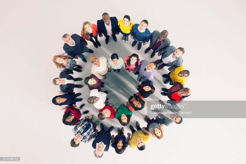 Portrait of diverse crowd in huddle