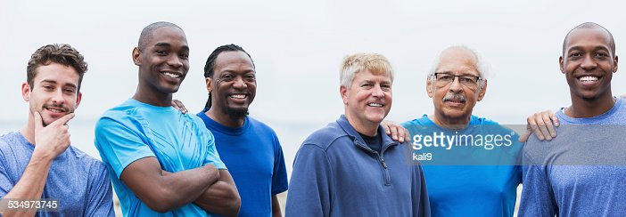 Portrait of diverse group of men standing outdoors