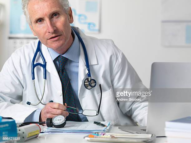 Portrait of doctor consulting a patient in office