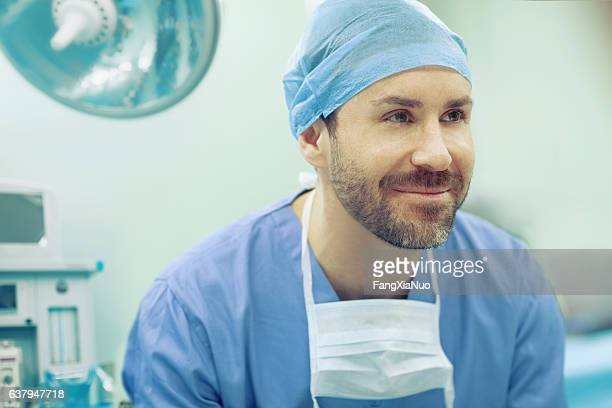 Portrait of doctor smiling in hospital operating room