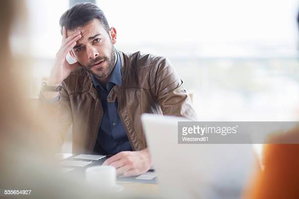 Portrait of doubting businessman