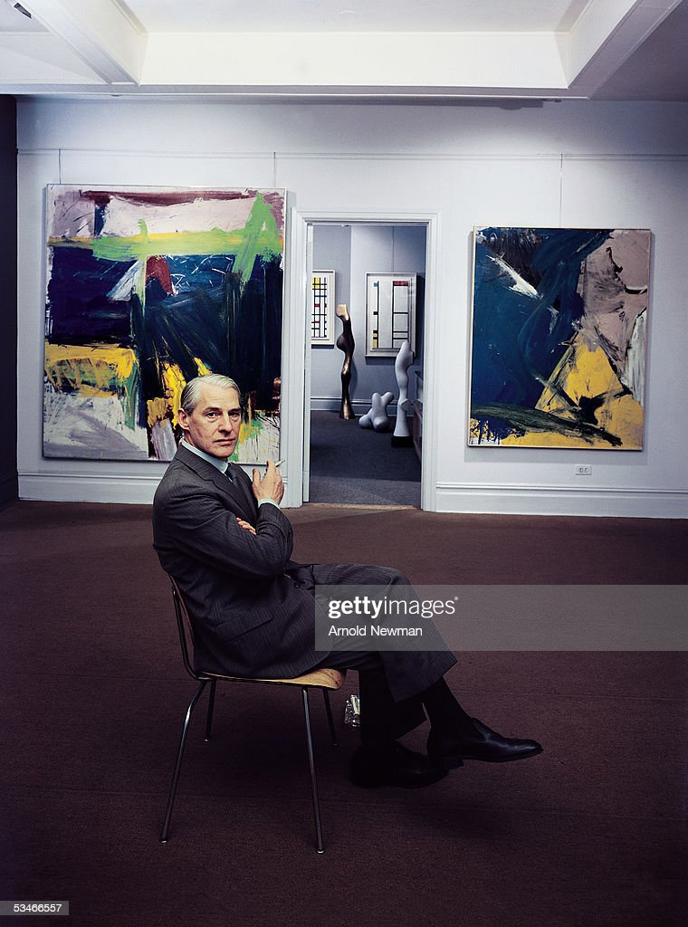 Portrait of Dutch-born American artist Willem de Kooning (1904 - 1997) with two of his paintings at the Sidney Janis Gallery, New York, New York, June 15, 1959. The painting at the left is titled 'Ruth's Zowie.'