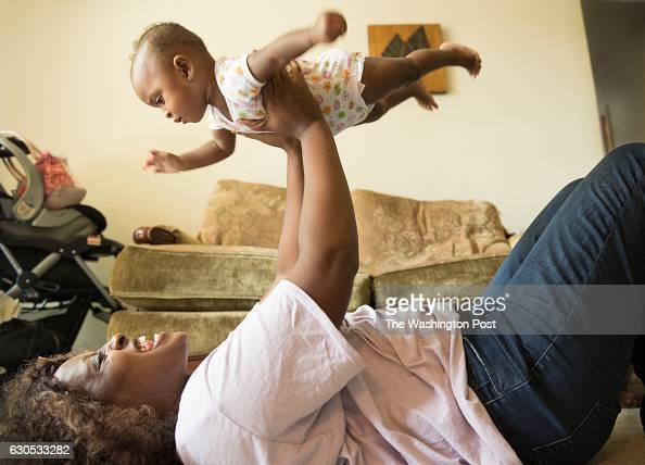 Portrait of Ebony Price a single mother of two children and a longterm DC welfare recipient with her 9monthold baby Lauryn Lindsay in Washington DC...