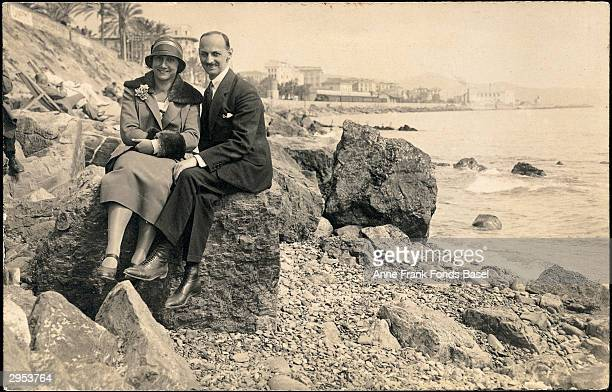Portrait of Edith and Otto Frank parents of German Jewish diarist Anne Frank sitting on a rock at the seashore in Amsterdam the Netherlands during...