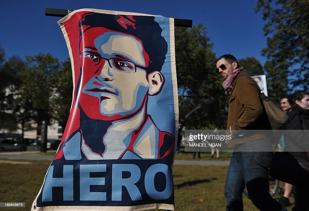 A portrait of Edward Snowden declaring him a 'hero' is seen during a protest against government surveillance on October 26, 2013 in Washington, DC. The disclosures of widespread surveillance by the US National Security Agency of US allies has caused an international uproar, with leaders in Europe and Latin America demanding an accounting from the United States. AFP PHOTO/Mandel NGAN