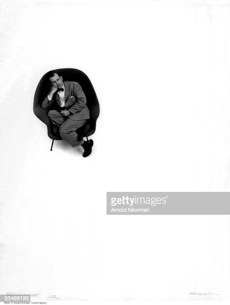 Premium Rates Apply Minimum rate $500 USD 377227 01 Portrait of Eero Saarinen architect and furniture designer in one of his chairs September 6 1948...