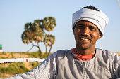 Portrait of an Egyptian man on a felucca on the Nile River near Aswan, Egypt