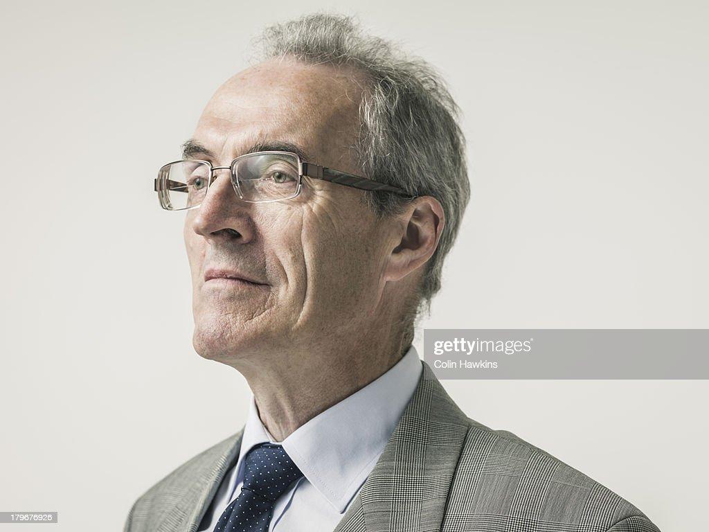 Portrait of elderly buiness man : Stock Photo