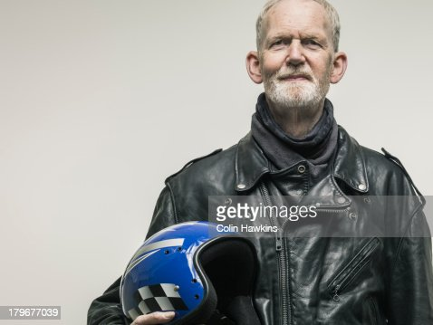 Portrait of elderly male motorcyclist