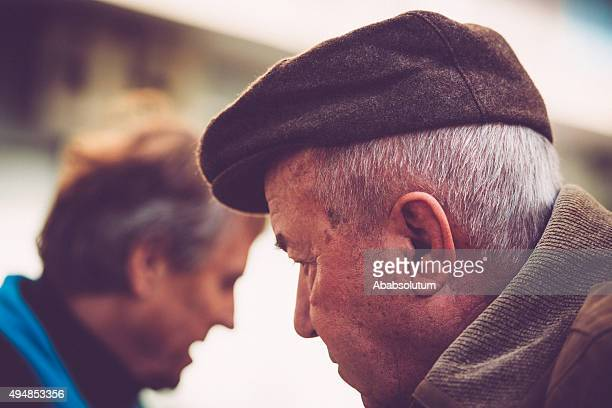 Portrait of Elderly Man and Son Outdoors, Europe