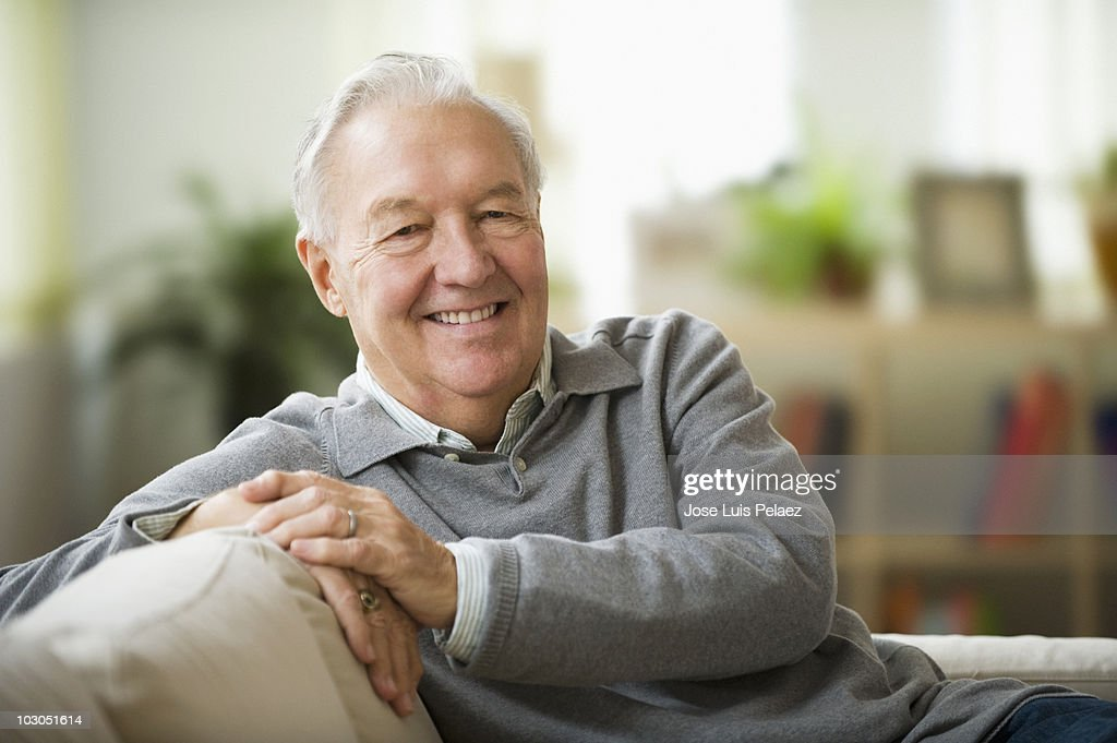 Portrait of elderly man on the couch : Stock Photo