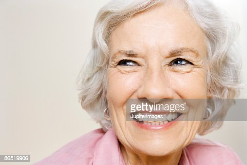 Portrait of elderly woman grinning : Stock Photo