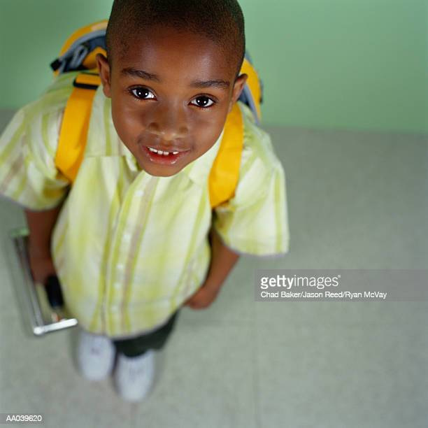 Portrait of Elementary Student with Lunch Box